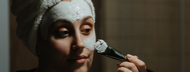 image of person applying face mask